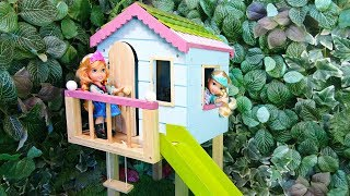 Elsa and Anna toddlers have a tree house