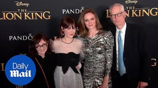 Zooey and Emily Deschanel stun on 'Lion King' red carpet