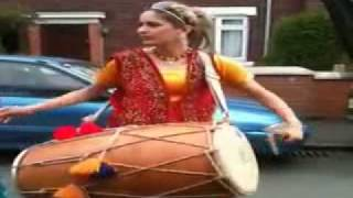 Pakistani Girl Playing with Dhol In UK.  must see and comments Please.flv
