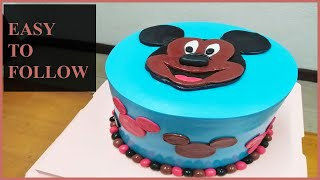 Cut out your own mickey mouse with fondant. No edible print or paper cards needed.
