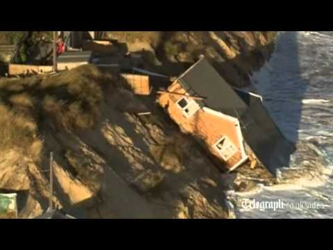 Aerial view: homes fall into sea in Hemsby, Norfolk after tidal surge