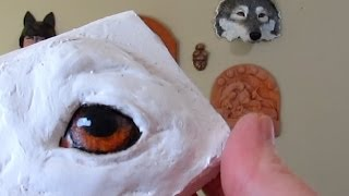 Painting Dog Eyes On Paper Mache Sculpture