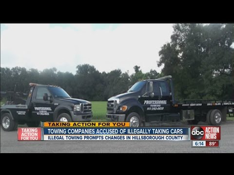Tampa tow truck grabbed legally parked cars