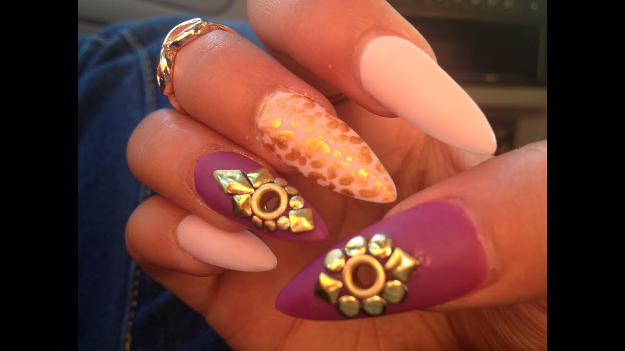 Purple And Gold Stiletto Nails With Eyelets