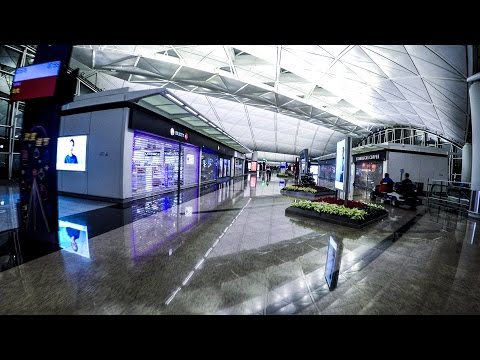 Hong Kong Airport. A Long Walk Through Gates, Shops and the Cathay Pacific Business Lounge