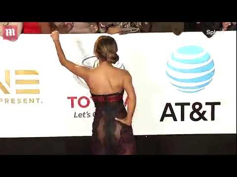 Download Youtube: Video  Halle Berry on the NAACP Image Awards carpet in red strapless