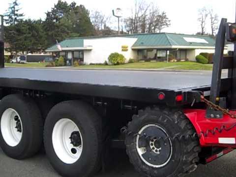 2000 International 9100i 24 Flatbed W Moffett Forklift