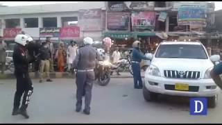 Lahore traffic wardens and Dolphin Force workers are hitting the car