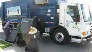 The Long Beach Garbage Truck Collecting The Goods...