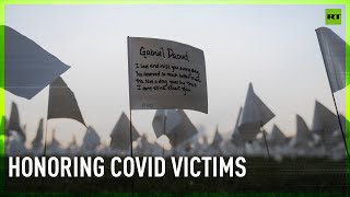 Over 600.000 white flags displayed to honor COVID-19 victims Washington DC