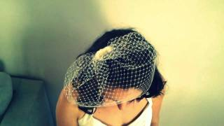 Placing fascinator into 9inch birdcage veil Thumbnail