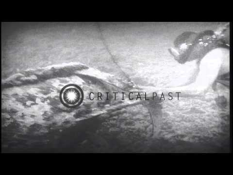 An underwater diver examines a Japanese midget submarine off Pearl Harbor in Oahu...HD Stock Footage