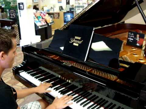 Playing a brand new $175,000 dollar 9 ft Yamaha Grand Piano