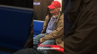 Subway creatures  man red hat eats chicken nuggets from pocket