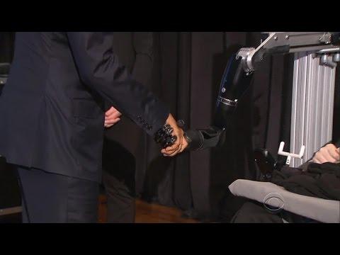 President shares monumental handshake with paralyzed man