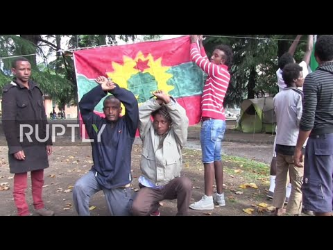 Italy: New refugee camp opens in Como - YouTube