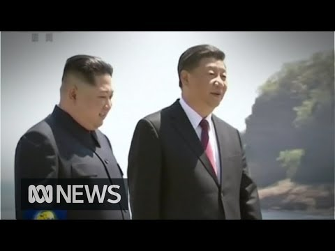 China, North Korea leaders stroll along the waterfront