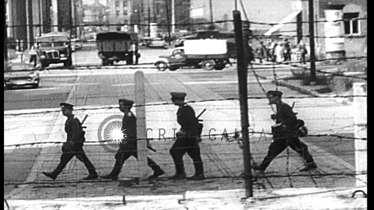 East german guards across the wall of shame and us soldiers march east german guards across the wall of shame and us soldiers march past in west behd stock footage amipublicfo Images
