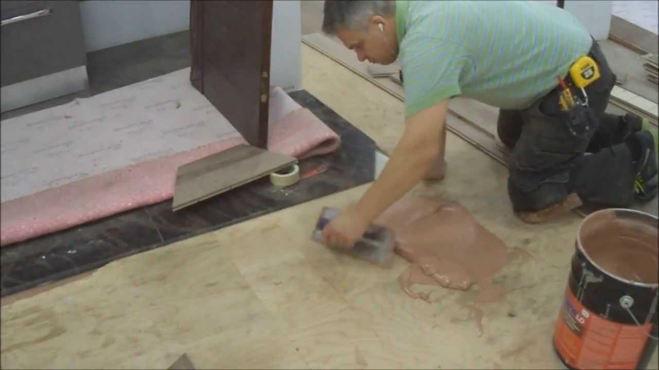 How To Installing Hardwood Flooring Glue Down In The Basement Around A Bar  Mryoucandoityourself