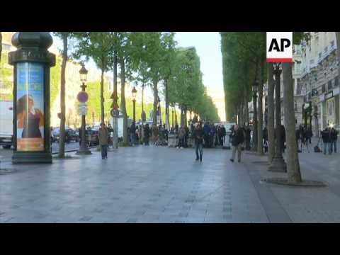Champs-Elysees reopens after gun attack
