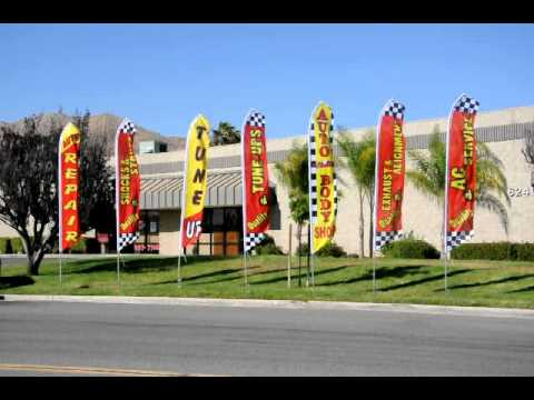 Auto Repair and service feather banner flags in action -  Featherflagnation.com
