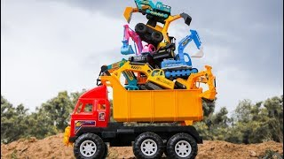 Fine Toys Construction Vehicles Looking for Cars in the Sand