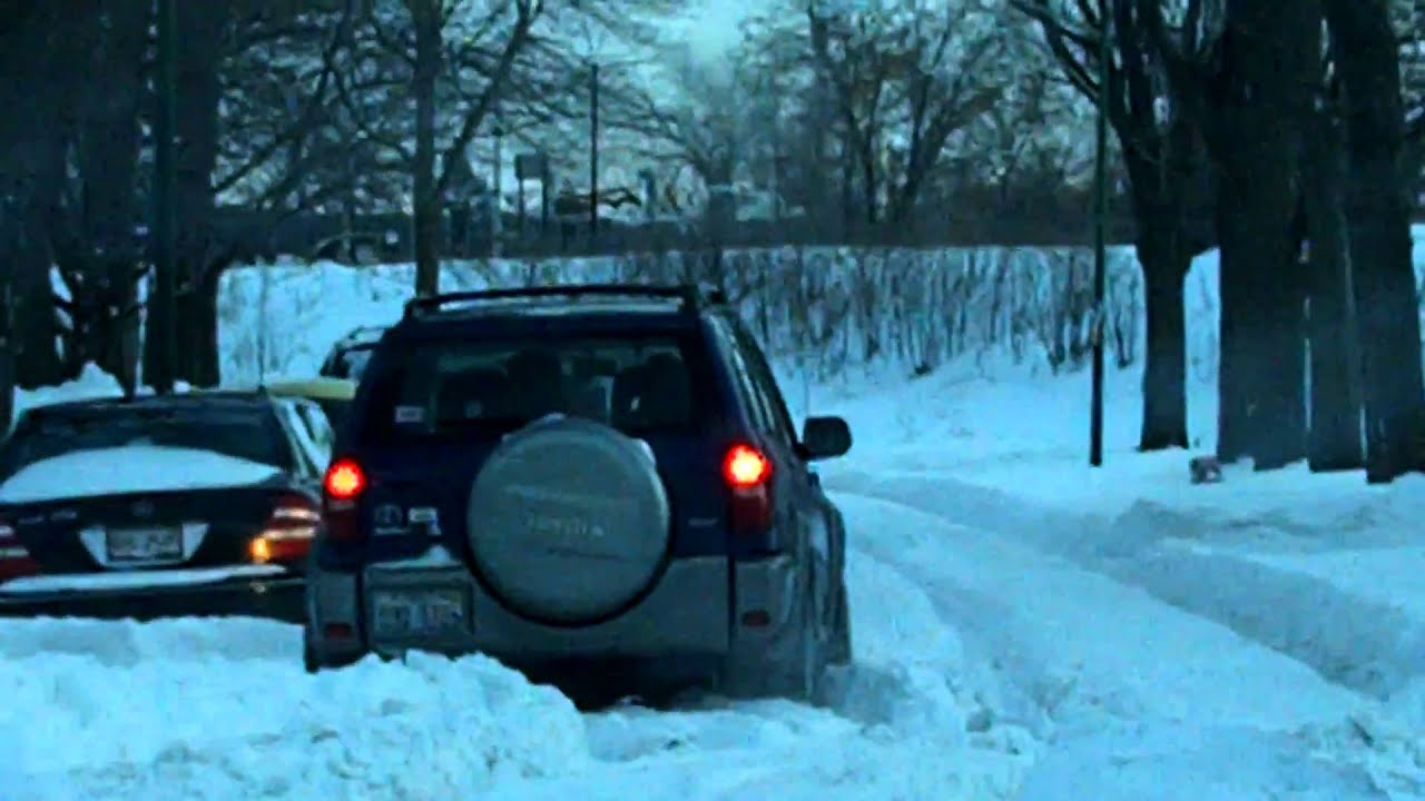 how to get a car stuck in snow out