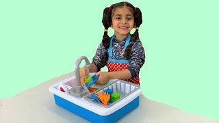 Sally playing wash and clean with Toys for children