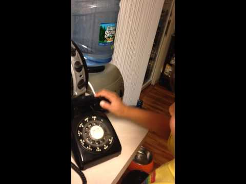 9 year old boy trying to use a rotary phone...hilarious