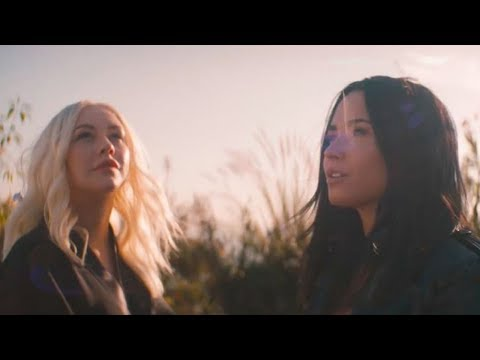 "Fan Theory Suggests Demi Lovato & Christina Aguilera SLAM Disney in ""Fall in Line"" Video"