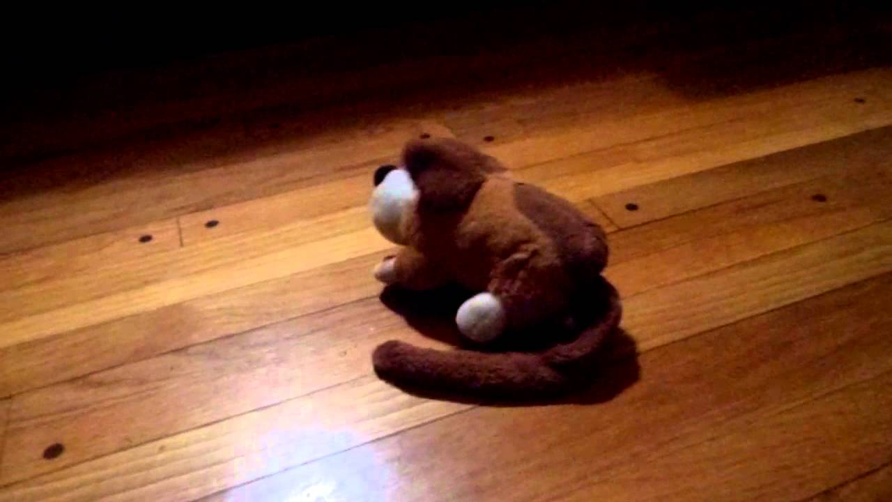 Silly animated goffa plush rofl dog rolling on the floor