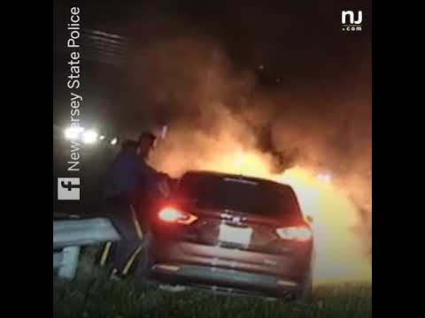 Video shows Troopers' frantic rescue of unconscious crash victim as car is engulfed in flames