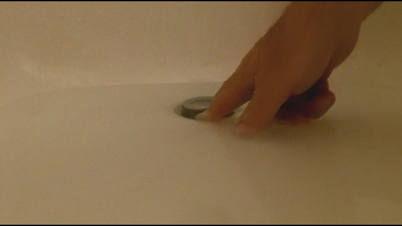 How to unclog a bath tub push drain - YouTube