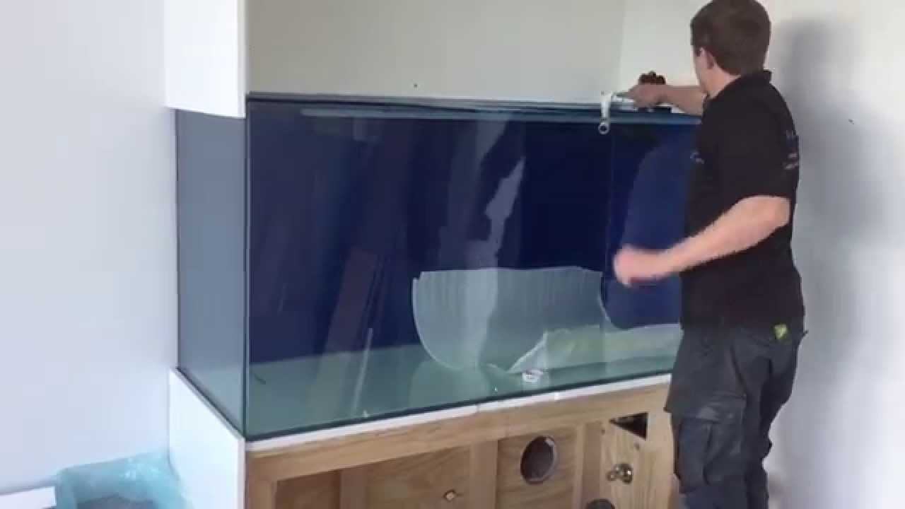 Installing An Aquarium In The Wall Of A Lovely Water Front