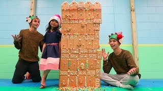 WE BUILT THE BIGGEST GINGERBREAD HOUSE WITH OUR LITTLE SISTER!