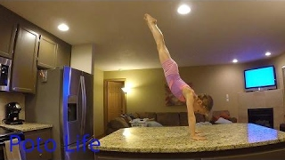 Handstands on counter tops. Kitchen gymnastics