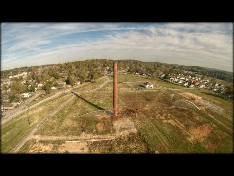 Historic Avondale Mills smokestack implodes and falls on backhoe!