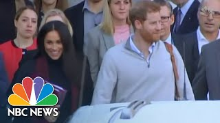 Beaming Meghan Markle And Prince Harry Arrive In Australia As News Of Pregnancy Breaks | NBC News