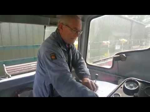 Driver for a fiver at rocks by rail.