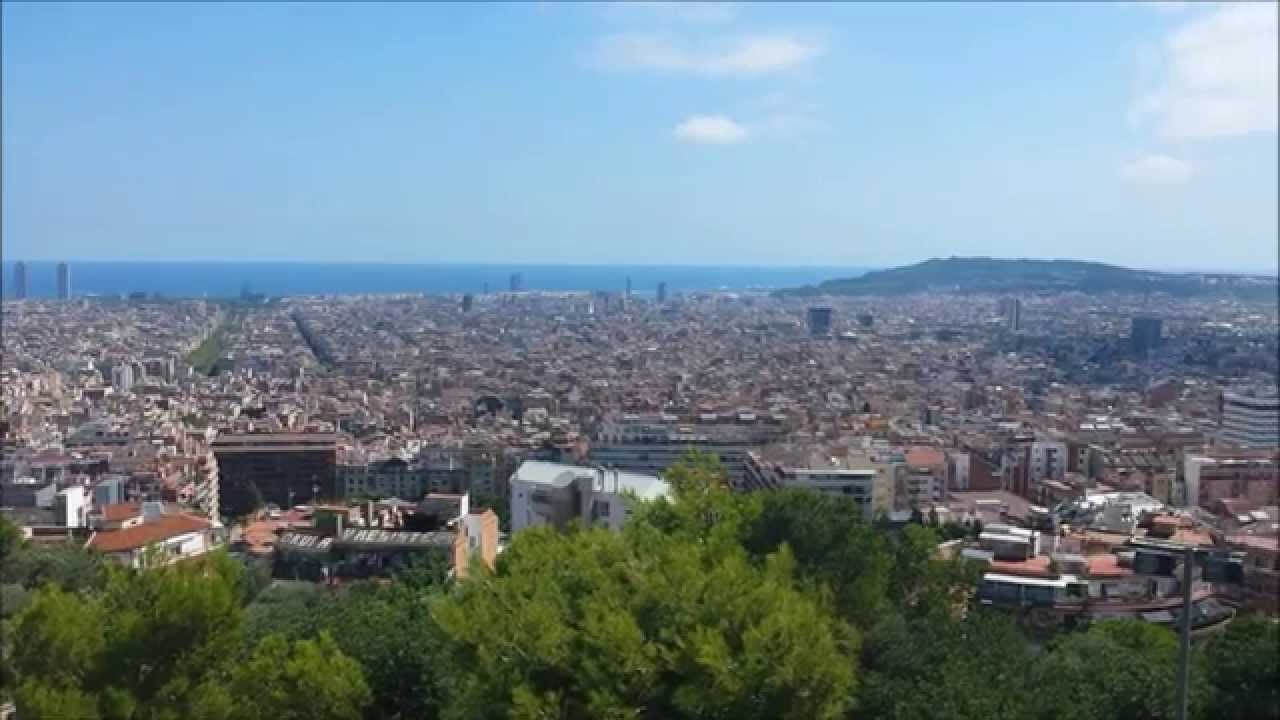 Download Panorama of Barcelona view from Park Güell. Sagrada Família. Free Parrots