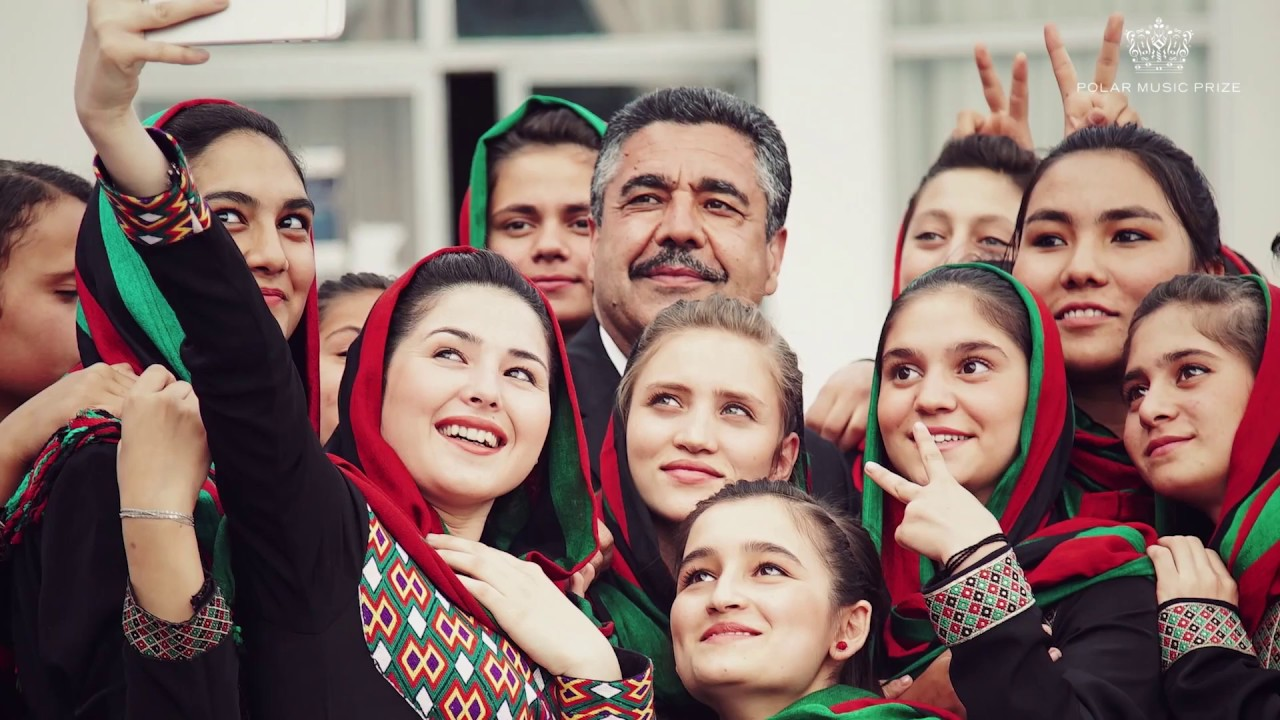 Afghani happy girls at music school