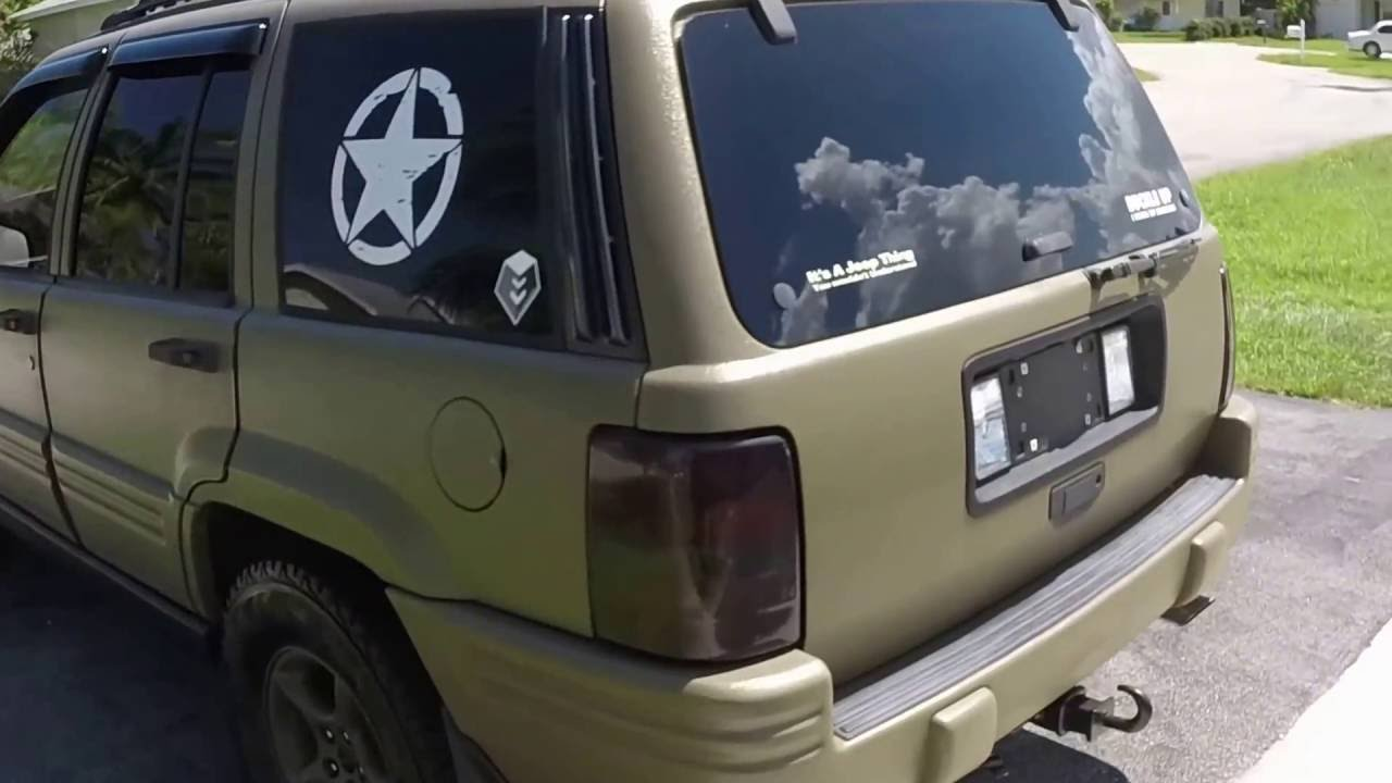Raptor Lined 96 ZJ 5.2 in OD Green 2 years later - YouTube