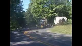 oversize load destroying road getting stuck