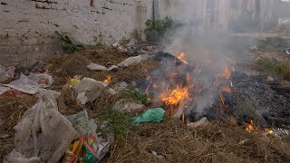 A burning garbage dump polluting the environment by producing harmful smoke - global warming