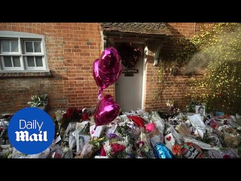 Floral tributes are left outside the home of George Michael - Daily Mail