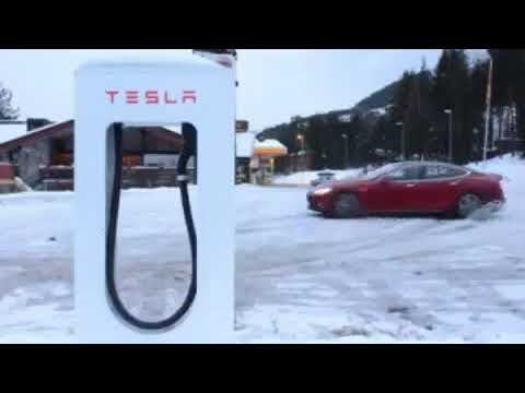 Snow Drifting In Tesla Model S. Supercharger