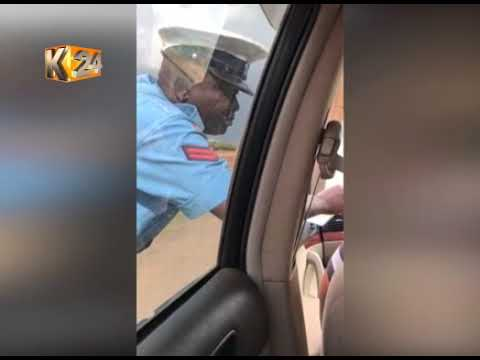 Officer caught on camera soliciting money from a Ugandan citizen