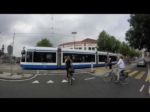 Biking from Amstel Station to Centraal Station in Amsterdam.