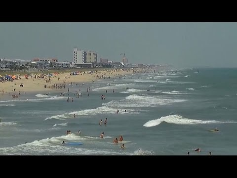MoneyWatch: Shark attacks spur call for action in North Carolina; MasterCard to experiment with f…