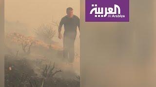 صور للعاهل الأردني مشاركا في إطفاء حريق كبير قرب عمان